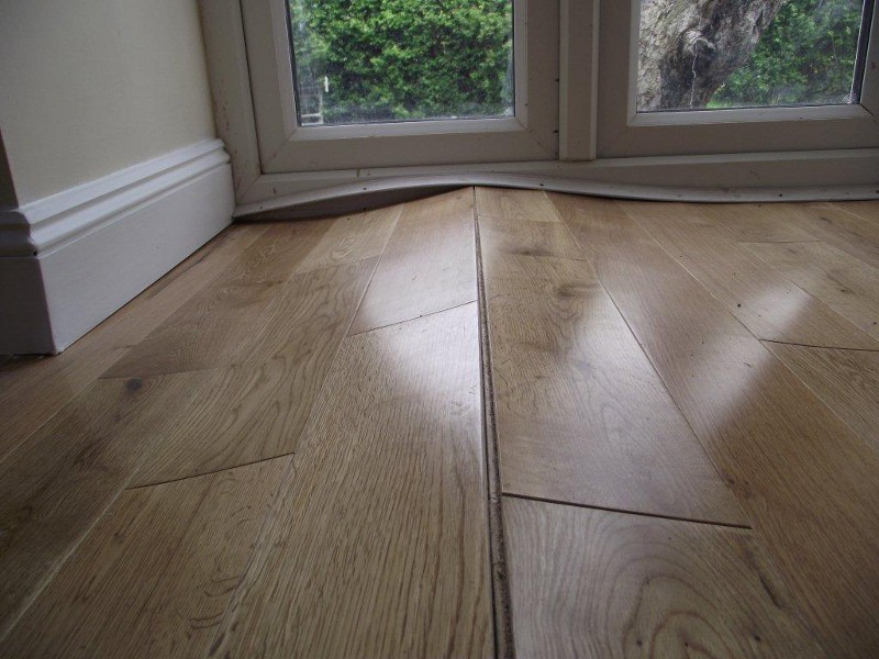 Warped Floorboards Caused Humidity Swings Woodfloordoctor
