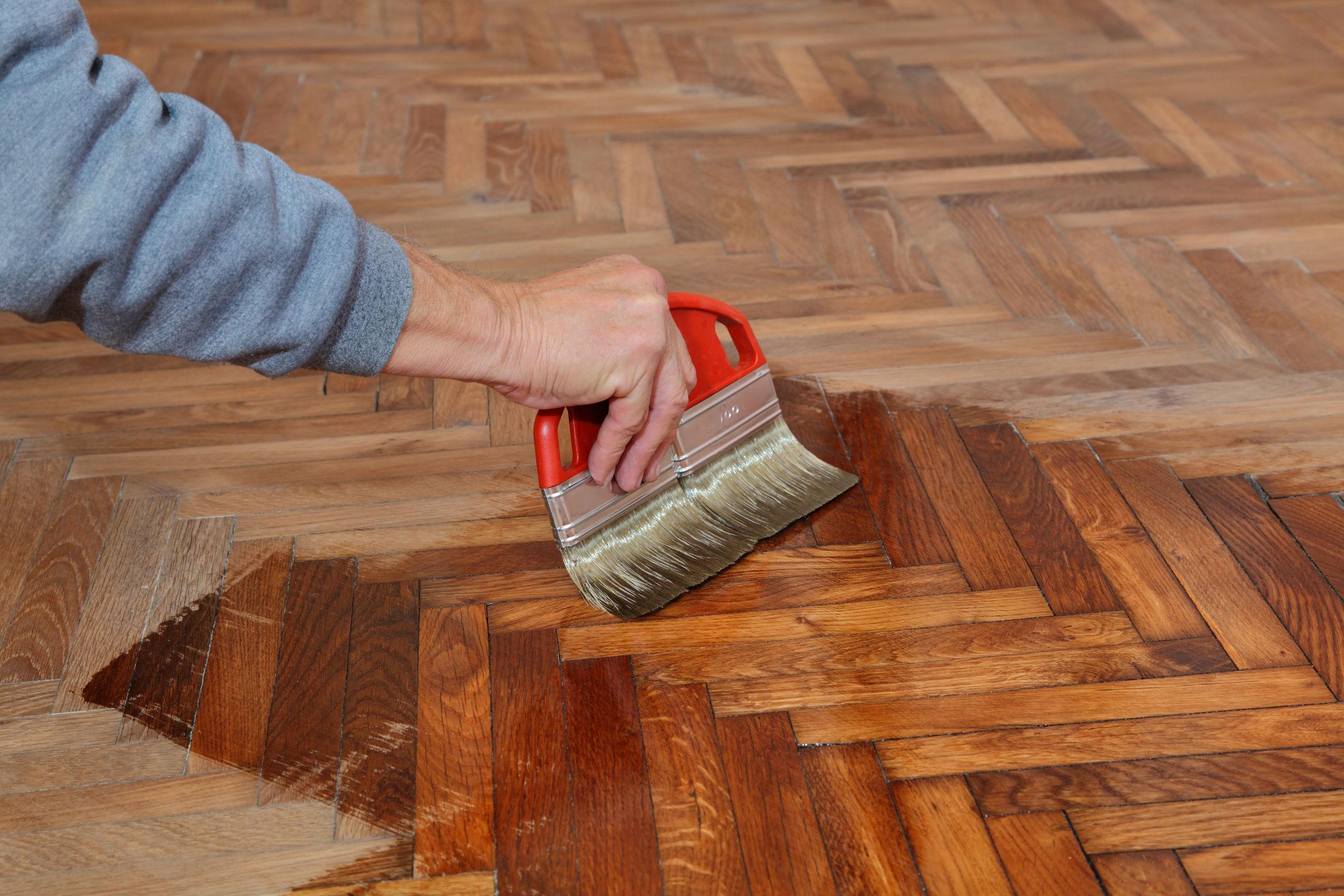 22815687 Varnishing Of Oak Parquet Floor Workers Hand And Brush