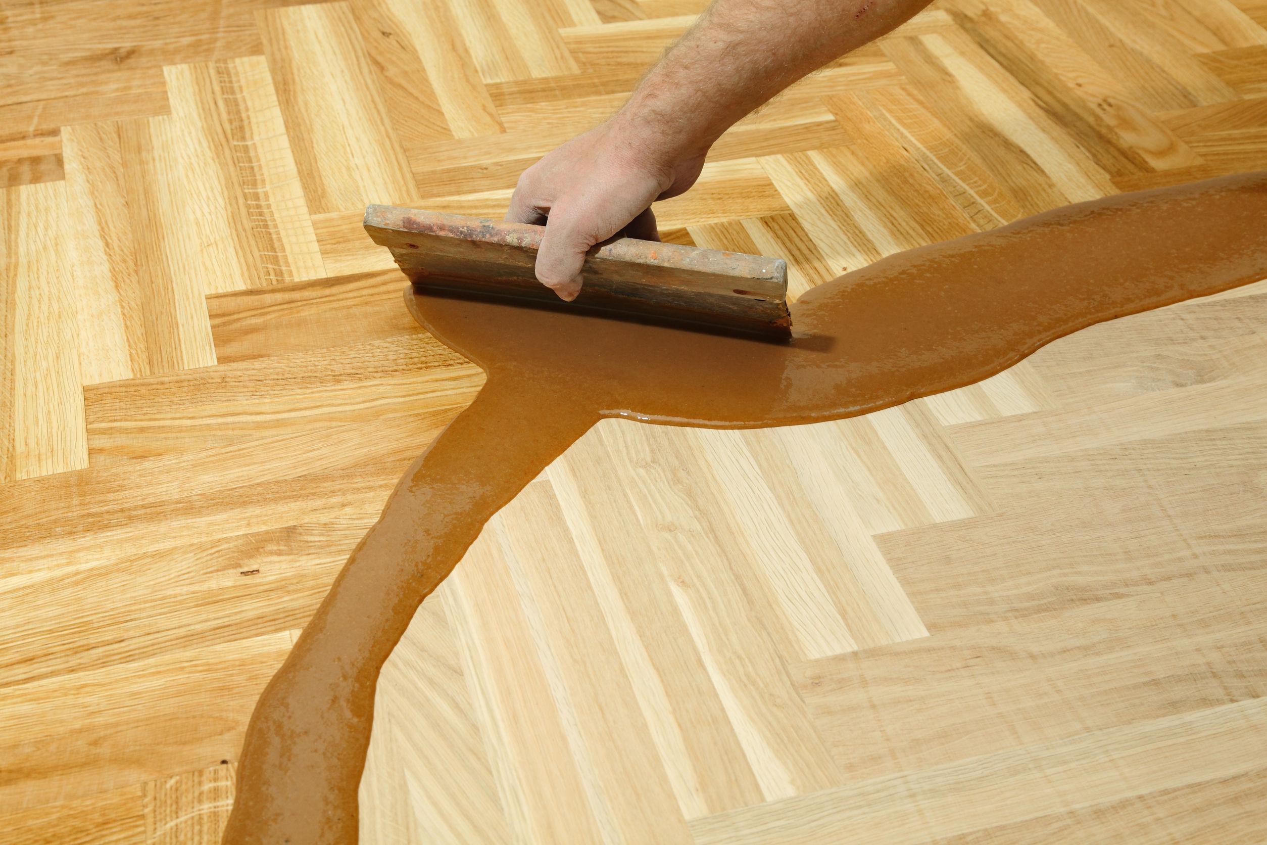 24527478 Varnishing Of Oak Parquet Floor Workers Hand And Tool