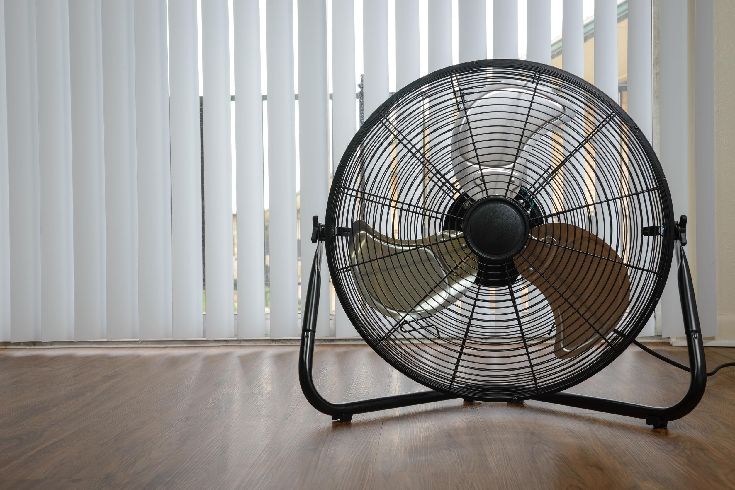 53210778 Black Metal Ventilation Fan On Wooden Floor